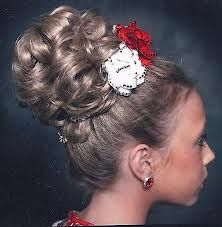 Lucy Bun Wig with white and red roses as the head piece