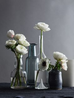 Take one bunch of same color flowers and mix into various heights/shapes/colors of vases.