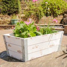 A fantastic addition to the home or garden this white shabby chic style planter is made from wood with zinc detailing to the corners of the box. Finished in a rustic distressed style perfect for the garden or a country inspired home this rectangular planter comes with a waterproof lining ready for your favourite plants, flowers, and shrubs.