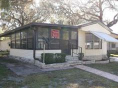 Great enclosed porch on thsi home! 1984 Fleetwood Mobile / Manufactured Home in Zephyrhills FL via MHVillage.com