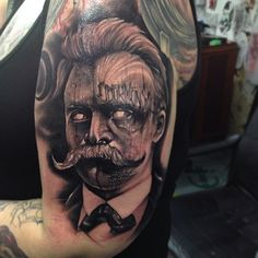 That's a very dark, even scary portrait by Anrijs Straume! nietzsche tattoos