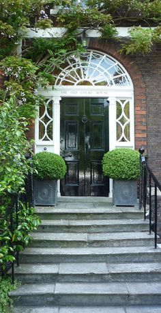 Black front door, brick exterior with white trim. The Old Court House: Richmond Green, London Grand Entrance, Entrance Doors, Richmond Green, England Countryside, Black Front Doors, Porche, Garden Steps, House Front, Front Porch