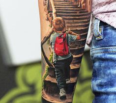 Realistic full colors tattoo of Children by artist Levgen Tattoo