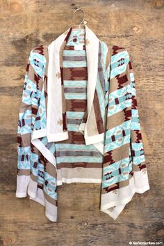 This boho chic cardigan will be your go-to sweater all season. A subtle blend of colors of burgundy and blue. Tribal Print Cardigan, Aztec Prints, Cardigans, Sweaters, Sweater Jacket, Boho Chic, Scarves, Burgundy, Wraps