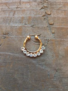 Cute Small Fake Rhinestone Nose Ring, Tribal Gold Faux Septum Piercing from Dempsey & Gazelle. Saved to Jewelry. Septum Piercing, Faux Septum Ring, Cool Piercings, Fake Piercing, Septum Jewelry, Body Jewelry, Cute Nose Rings, Fake Nose, Bronze