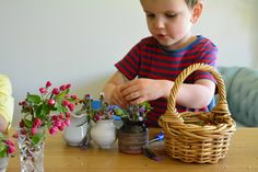 Flower arranging at three years at How we Montessori