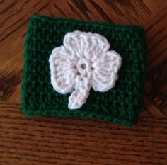 Green Cozie with white shamrock. Perfect for St. Patrick's day! Check out LDJ Crochet on Facebook!