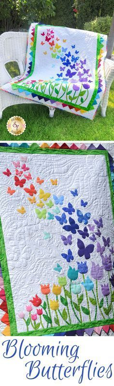 """Blooming Butterflies Quilt Kit Brighten your little girls room with this darling Blooming Butterflies Quilt! This Shabby Fabrics Exclusive quilt features a beautiful array of butterflies floating on a gentle breeze over a bed of blooming tulips, finished with bright prairie points for the inner border. Finishes to 40½"""" x 51½"""". All applique shapes are pre-cut and pre-fused for your convenience."""