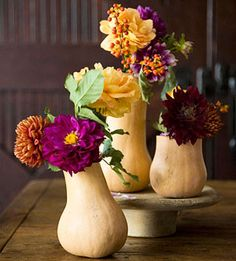 Beautiful butternut squash vases - these would be fun for a halloween party and you could bake them after the event! YUM!