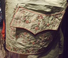"Pocket detail in a waistcoat, most likely French. Embroidered in chenille. From ""Descente en Enfer..."" post in Temps d'Elegance blog, in which the blogger visits an antique costumes sale."