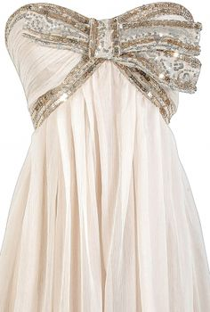 Chiffon strapless dress with jewel-encrusted bow.
