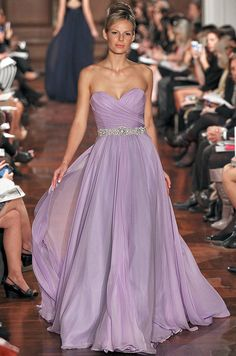 A glamorous strapless wedding dress dons an ethereal purple hue. - Radiant Orchid