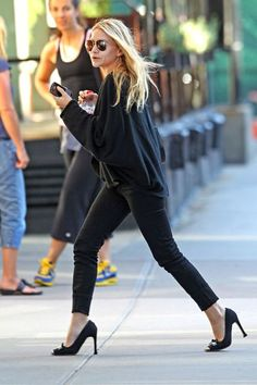 15 Ways To Do New York City Like An Olsen Twin #refinery29  http://www.refinery29.com/olsen-twins-nyc-pictures#slide-13  When: August 2011Where: East VillageAshley struts her stuff while leaving her home away from home, The Bowery Hotel, in an all-black look (which features a loose black sweater, cuffed skinny jeans, and a pair of classic, bowed Louis Vuitton heels).