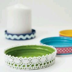 Recycle jar lids to make candle holders