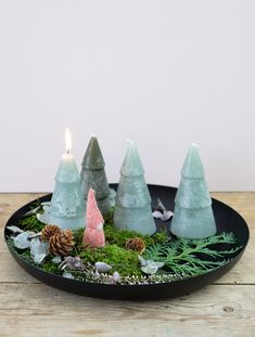 """Create your own Advent decoration by ornamenting a dish with greenery from the forest, candles and a homemade elf.  """"Always remember to keep an eye on lit candles and make sure they do not burn all the way down,"""" Clara friendly reminds us."""