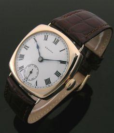 A gold cushion vintage Zenith watch, 1930s