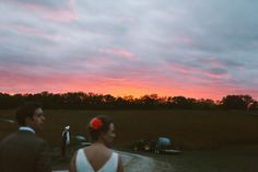 Wedding photography: Bride and groom candid sunset portrait.