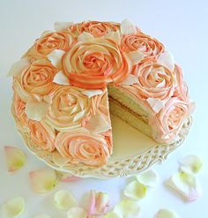 Shabby Chic Rose Cake-Sliced  Moist White cake, filled with lemon and raspberry curds, festooned with buttercream roses and white chocolate leaves. recipes and tutorials at www.baking911.com