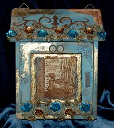 "Altered key cabinet. made for and published in the ""Craft stamper"" magazine."