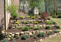 Photo of Greenshooz Landscaping and Lawn Maintenance - Cumming, GA, United States. Tiered Landscaping with dry stacked retention wall Landscaping A Slope, Landscaping Retaining Walls, Landscaping With Rocks, Landscaping Ideas, House Landscape, Landscape Plans, Landscape Design, Sloped Backyard, Sloped Garden