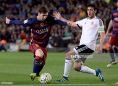 Barcelona's Argentinian forward Lionel Messi vies with Valencia's midfielder Daniel Parejo during the Spanish league football match FC Barcelona vs...