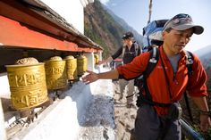 Instructors Dawa Sherpa and climber Pete Athens, co-program director with Steve Mock, turn prayer wheels on the approach hike from Lukla headed for Phortse, where the school is located. It is believed that spinning the wheels has the same meritorious effect as orally reciting the prayers.