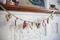 Fabric heart garland-too cute (great scrap-busting idea)! Also, love the button accents...