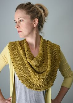 The Jeera Shawl-Cowl is a hybrid piece. It is knit like a cowl, but designed to look like a semi-circular shawl draped around the neck. It is worked in alternating bands of garter stitch and a very simple textured openwork stitch pattern and begins as a shawl knit flat. When the top edge reaches the appropriate length, the two ends are joined and worked in the round to the end. A picot border finishes the piece.