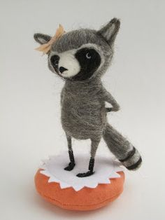 Adorable felted raccoon by Lesley-Anne Green