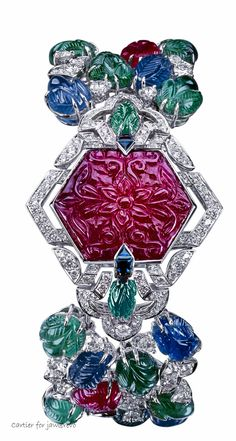 From Cartier's 2011 Mille et une Heures jewelry watch collection – Cartier's Tutti Frutti Secret Watch – emeralds, rubies, diamonds and sapphires. The timepiece is hidden behind the carved ruby.