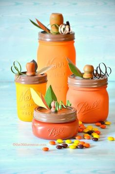"""Paint a Mason jar and top it with a faux stem for a """"pumpkin"""" you can display every year. Get the tutorial at The 36th Avenue."""