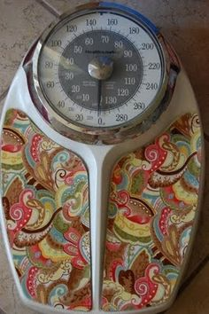 Refashion your bathroom scale with some fabric.