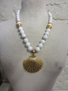 Hey, I found this really awesome Etsy listing at https://www.etsy.com/listing/170152724/huge-70s-80s-gold-tone-shell-and-white