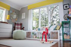 Name: Graham Age: 7 weeks Location: Michigan Room size: 10'x10'   At first glance you might not guess that this creative, colorful space is primarily a mix of Ikea and diy projects, but it's true.  Amy and her husband Andy transformed a guest bedroom into a bright, perky, modern space for their newborn son, Graham, and we're entranced by the results.  They put their signature stamp on his nursery by sprinkling it with interesting artwork and, most notably, a bevy of beautiful fabrics…