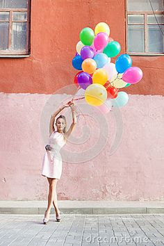 Beautiful lady in retro outfit holding a bunch of balloons betwe by Mikalai Bachkou, via Dreamstime