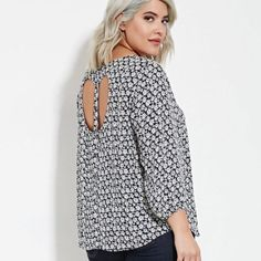 Daisy Print Cutout Back Top Daisy print navy and white relaxed fit blouse with button and heart cutout back detailing / buttons at wrist and high round neck. Junior plus sizing. No stretch. NWOT  BRAND NEW- CURRENTLY ON THEIR SITE FOR HIGHER PRICE!  Forever 21 Tops Blouses