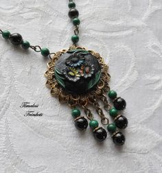 Notice how the ornate button is backed by brass filigree from which beads can be dangled.-- Flower Waltz Vintage Button Necklace with by TimelessTrinkets, $58.00