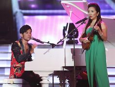 Taiwanese singer Jay Chou, left, and hostess Tao Chingying perform together during the award ceremony of the 24th Golden Melody Awards in Taipei, Taiwan, 6 July 2013.