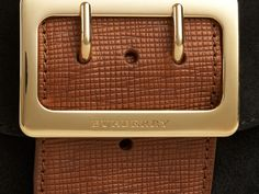 The Burberry Square Buckle Bag in English suede and textured leather with House check panel. Made in Italy, the design has a regimental belt detail with a polished gold metal buckle referencing the trench coat.