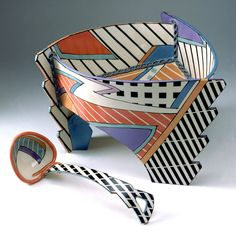 Porcelain bowl and ladel build with abstracted slabs. Painted in black, white, purple and orange/red colors in abstracted shapes with stripes. Collection: Cooper Hewitt Museum