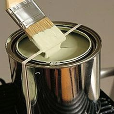 Use a rubber band around paint can to wipe excess paint off brush instead of side of can