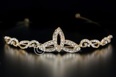 A beautiful, simple trinity Celtic knot tiara adorned with rhinestones.The length of the decoration is 7.5 inches and the height is 1 inch. Click here to see the matching hair pin.