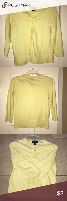 Pale yellow cardigan Pale yellow cardigan 3/4 sleeves. Button down; size medium. Great over dresses, to change your summer shirts to fall/winter shirts; looks great with jeans or slacks. Very versatile. Express Sweaters Cardigans