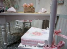 1:12th scale Dollhouse Miniature Shabby Chic Table, Chairs, and Accessories Set in Pink Roses.  via Etsy.