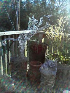 wire art wire sculpture cat .