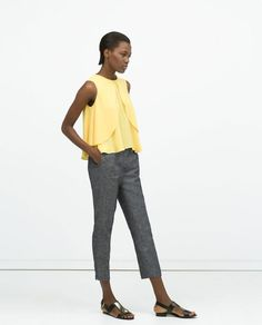 10 Unexpected Ways to Wear Our Favorite Spring Color: Sleeveless Blouse