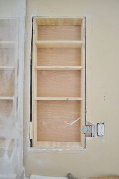 Between the Studs Storage - A TutorialUsing Stair Tread Nosing as Finishing Trim on Built-in ShelvesBetween The Studs Storage - Adding More Storage to the Master Bathroom: