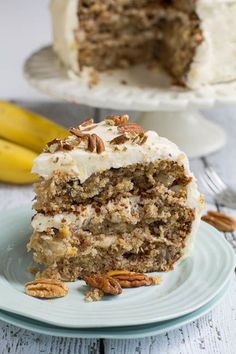 Hummingbird Cake - a dense and moist southern cake flavored with bananas, pineapple, and cinnamon and covered in a rich cream cheese frosting topped with toasted pecans.