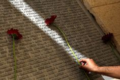 A man lays a flower on a monument engraved with names of victims of the September attacks Framed Print Framed, Poster, Canvas Prints, Puzzles, Photo Gifts and Wall Art 11. September, Framed Prints, Canvas Prints, Image Of The Day, Photo Archive, Poster Size Prints, Photo Greeting Cards, Memories, Flowers