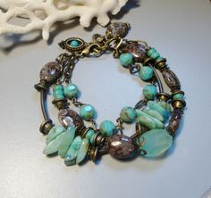 Turguoise, Chrysocolla,  Light Aqua Agate, Jasper and Czech Fire beads Bracelet. $55.00, via Etsy.